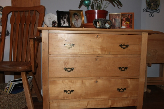My dad bought this dresser for my brother back in the 70s. It was painted white and had tacky wood knobs for handles. About 6 years I decided to strip it to see how it would turn out. There were layers of paint; white, pink, green. I couldn't believe this gorgeous piece of furniture was under all that yuck. I try to remember these things when I meet people I don't always like at first. I wonder what's beautiful under their yuck. I hope others offer me the same moment of consideration.