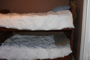Alexi has yet to decide which bunk he wants to sleep so instead he switches between the two - in the middle of the night.